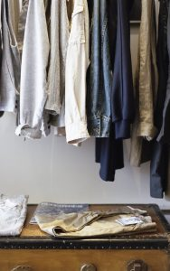 hanging clothes in the closet