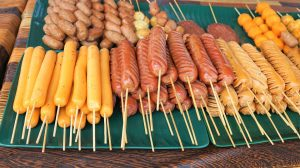 Corn dogs and hot dogs on sticks
