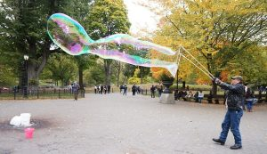 Making soap bubble in Central park