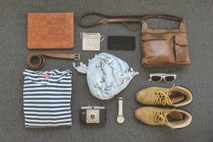 Shoes, t-shirt, bag, and wallet -your essential things for the move