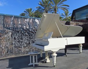 white piano should be carefully handled by piano movers NYC