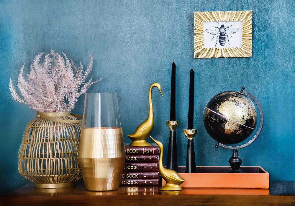 Tips for transporting collectible items. Books, vases, chandeliers, figurines and a globe on the table.