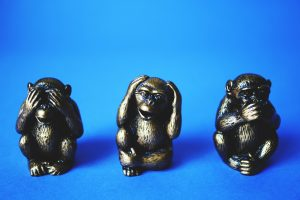 Figurines of 3 monkeys (see no evil, hear no evil, speak no evil).