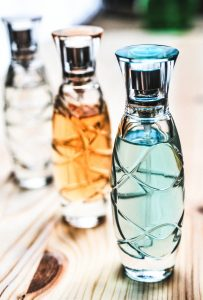 How to pack liquids for transport. Three bottles of perfume.