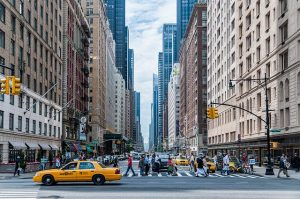 Best ways to commute in Manhattan. Manhattan street with yellow cab riding.
