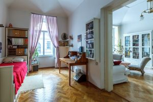 Renting vs buying a home in NYC. Bedroom and living room captured.