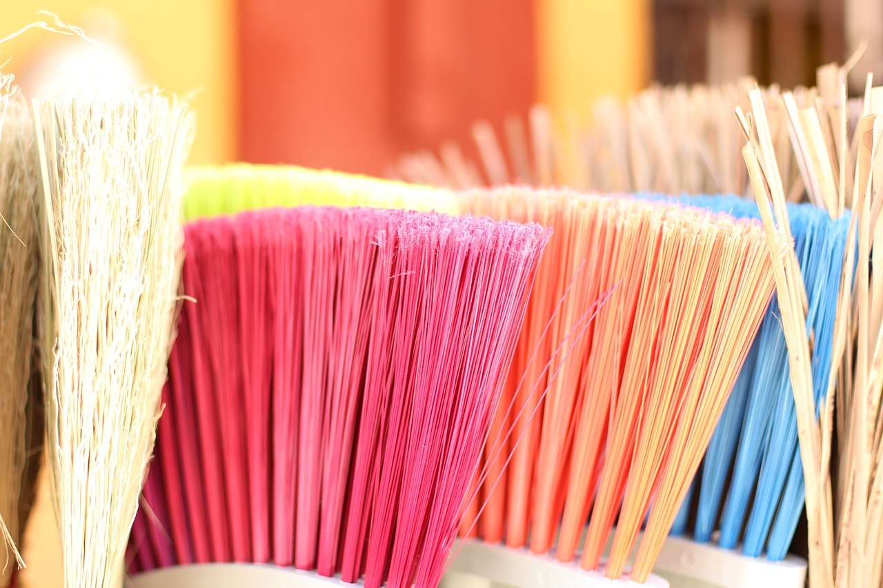 When is the best time to clean out your storage. Broomsticks in different colors.