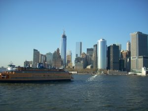 Ferry on the water, Manhattan behind.