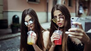 teenage girls drinking juice