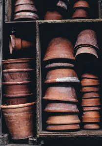 Image of flowerpots piled one on top of another