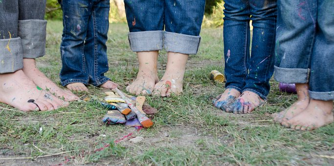 Legs of family while they are having a lot of fun in the park