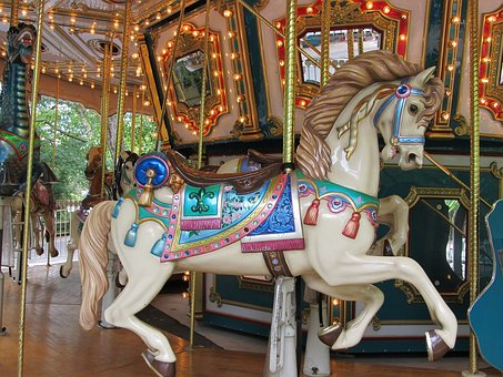 Wooden horse on the Carousel in Brooklyn - a great way to help your family adapt to Brooklyn