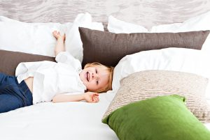 toddler on king size bed