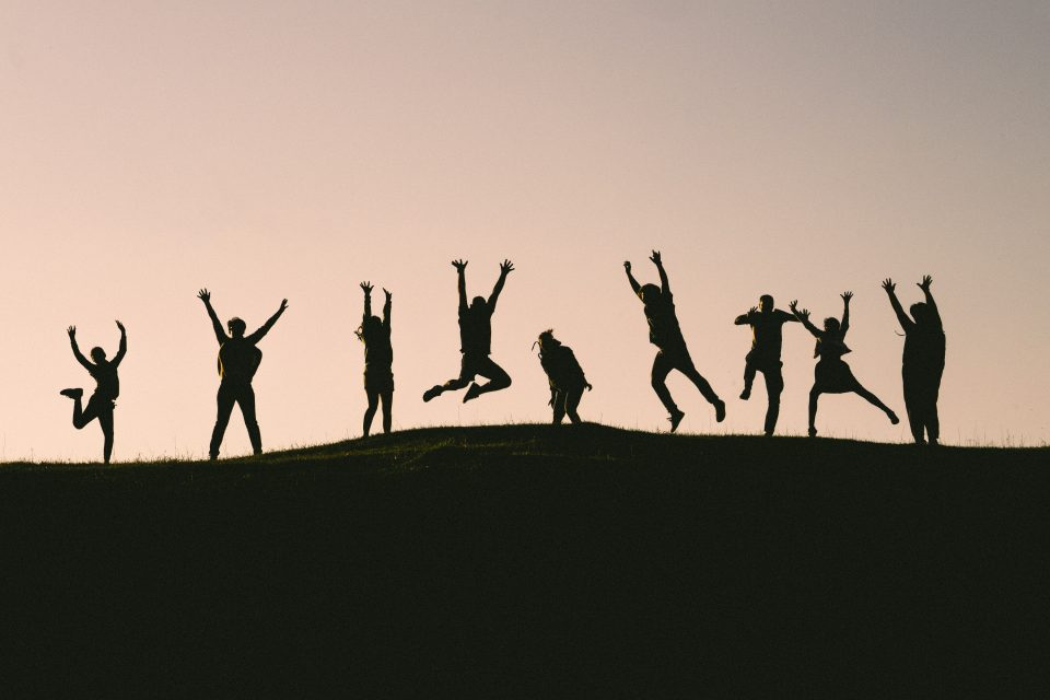 Silhouettes of happy people