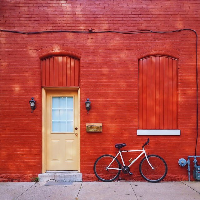 Red wall, bike and door