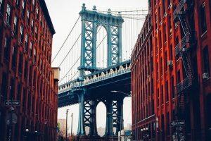 Bridge between two NYC red buildings