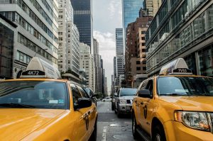 2 yellow taxis on NYC streets