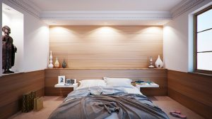 A guest bedroom with wooden panels may be the perfect option for the spare room in your home
