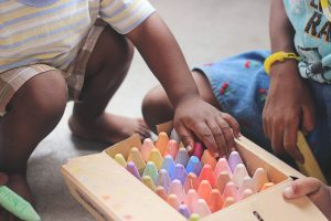 children playing with crayons