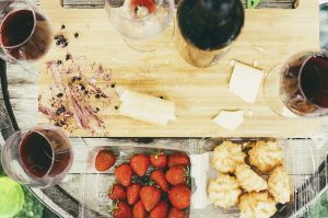 Cheese cutting board, wine, strawberries