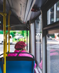 a woman sitting in a bus