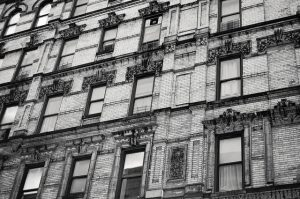 A NYC building facade. Maintenance costs should be a factor when choosing an apartment or house in NYC