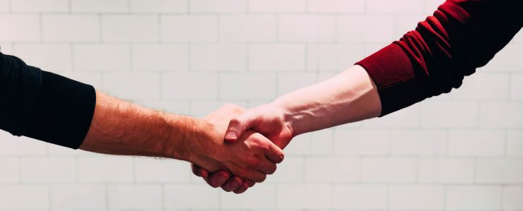 two people sharing a handshake