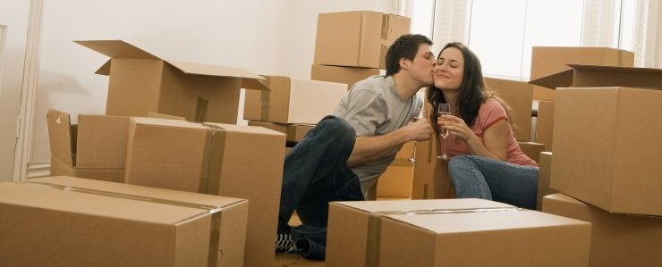a couple sitting among the moving boxes, representing Essex movers