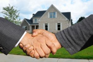handshake - hire quality real estate agent before you start flipping houses