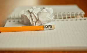 Picture of a notebook and a pencil