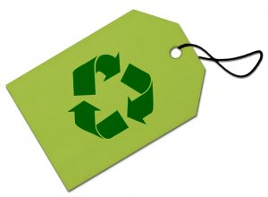 A paper tag with a recycling logo