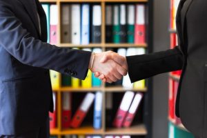 Two people shaking hands after hiring Morristown movers