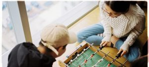 Man and woman playing foosball