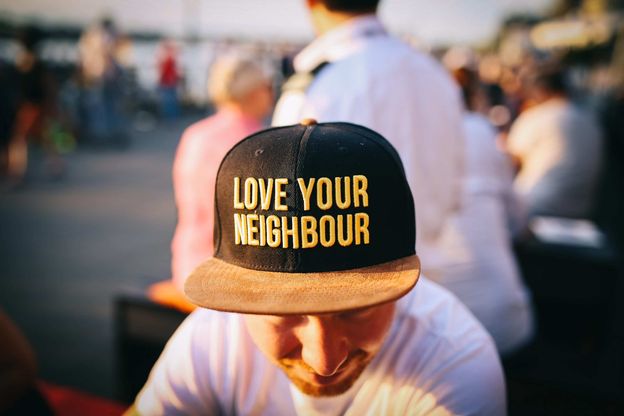 A man with the Love your neighbor cap