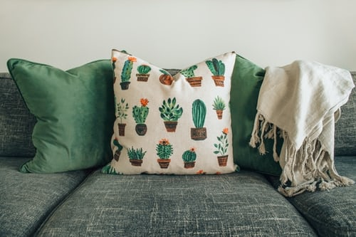 a sofa with pillows