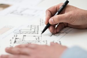 architect holding a black pen