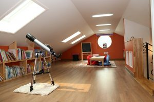 A attic with a telescope