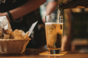 A person pouring beer