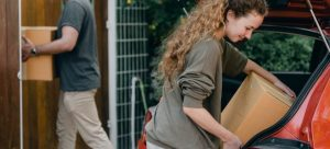 couple moving boxes without the help from Lafayette Township movers
