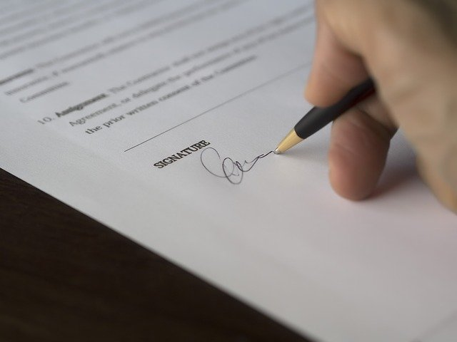 Signing a moving contract.